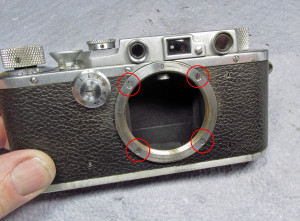 remove these 4 screws (red circles), carefully remove the lens flange as there may be shims between it and the camera body. Mine had none but there were several on my Nicca when I worked on it.