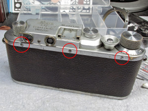 remove these screws (circled)