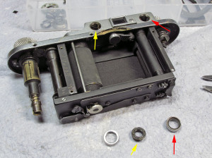 remove the two round front RF windows. The right one (red arrow) may or may not come off in two pieces. mine came off in one piece. The left window (yellow arrows) should come off in two pieces, the outer ring and the inner window that also adjusts the vertical RF view. Use a spanner to remove it's outer ring, the inner spanner slots adjust the RF. If your RF vertical view is already correct there should be no need to adjust it later