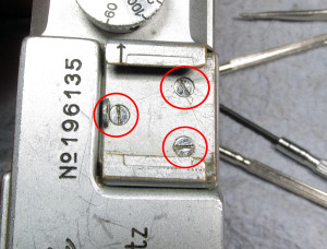 remove the 3 screws on the cold shoe (circles)